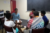 Ratu leading a discussion group